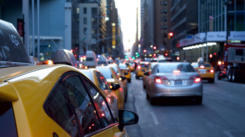A city street crowded with cars