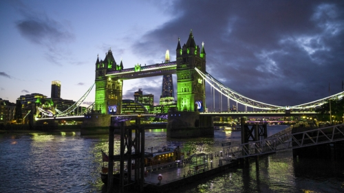 A picture of the Tower Bridge in London at night bathed in green light