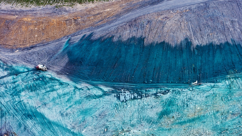 An image of a truck hydroseeding a former mine site